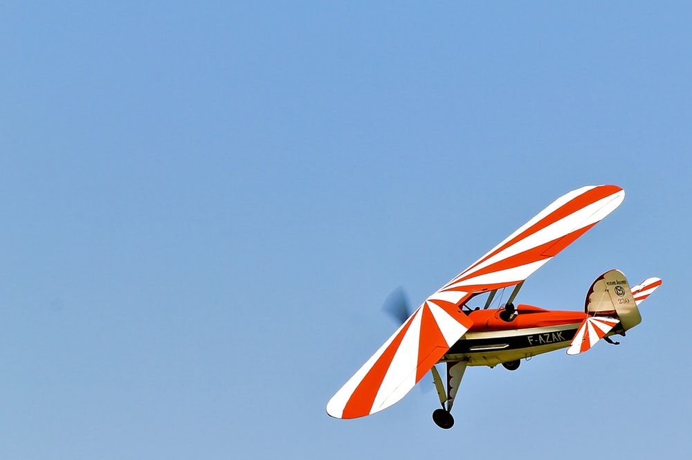white and red monoplane