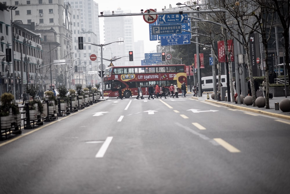 red bus on road