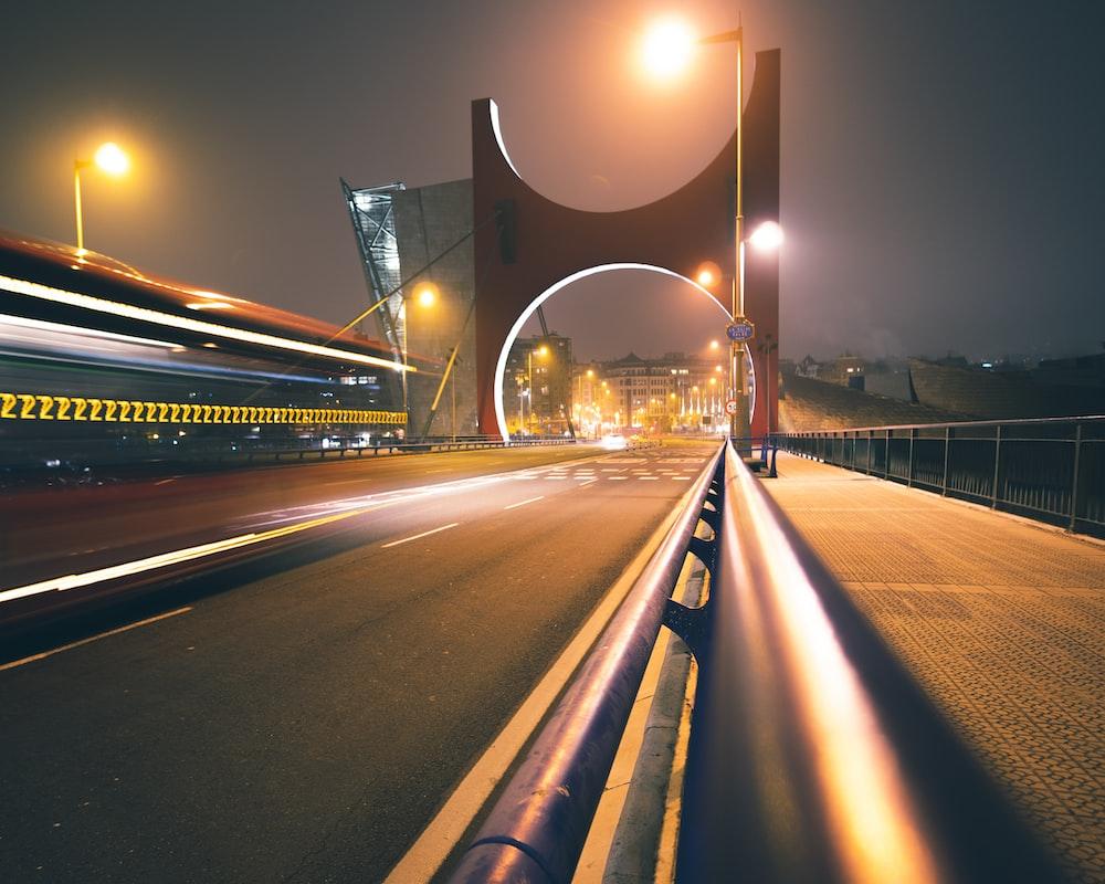 concrete bridge at nighttime