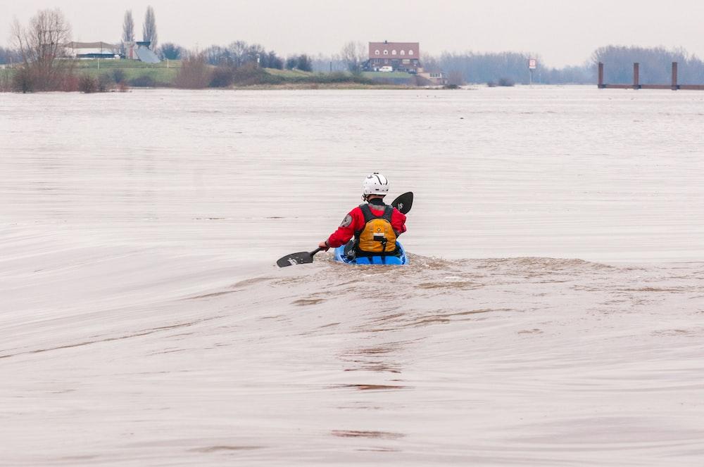 man in red jacket kayaking