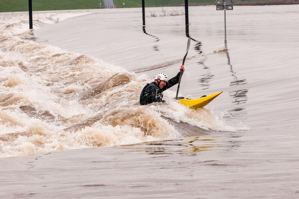 person riding yellow kayak