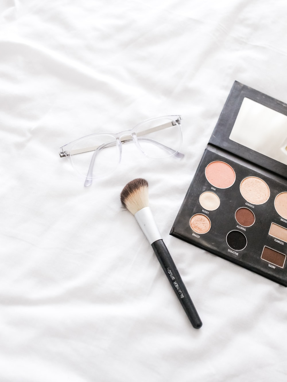 women's black makeup palette with brush