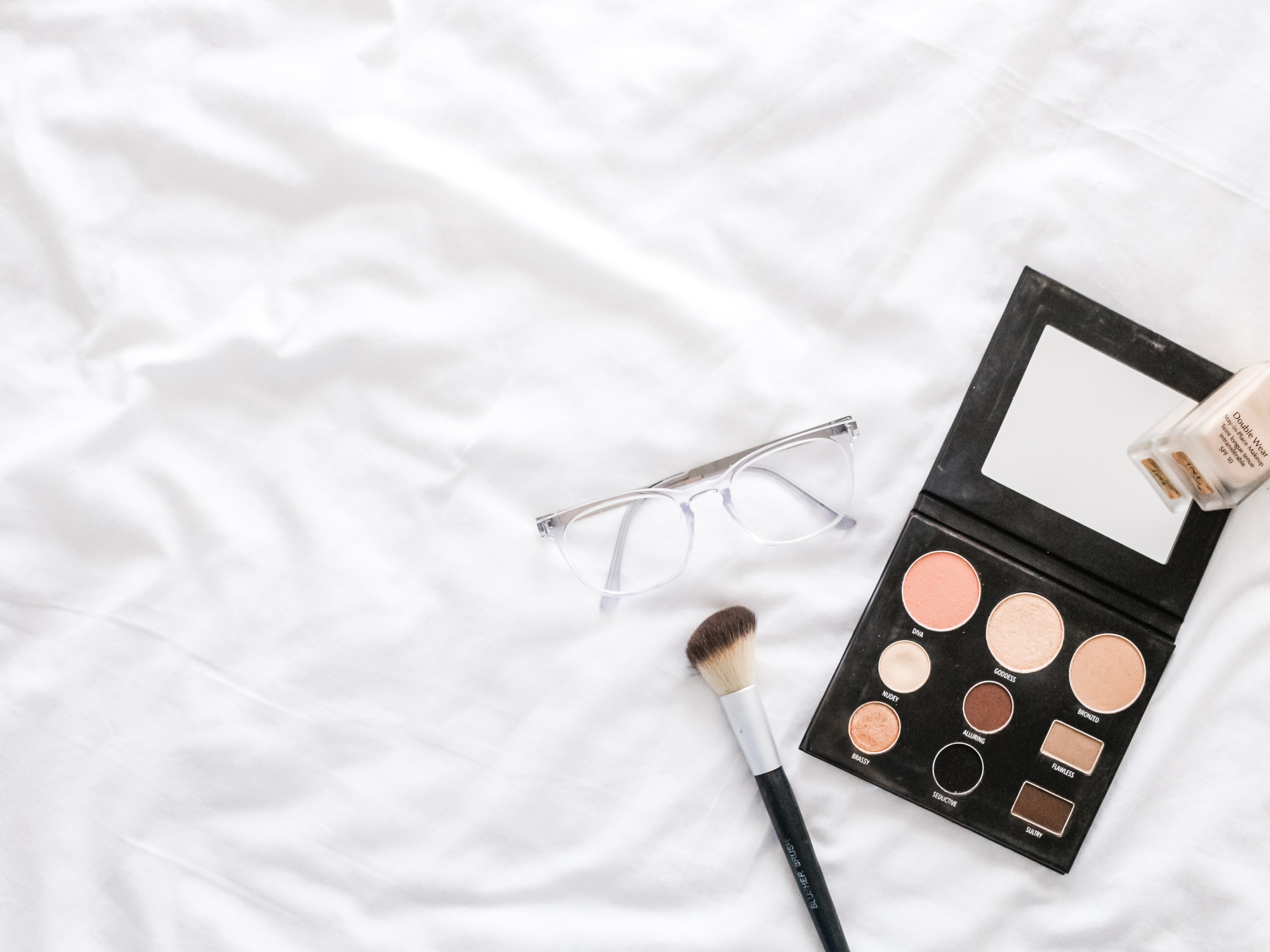 makeup palette and brush
