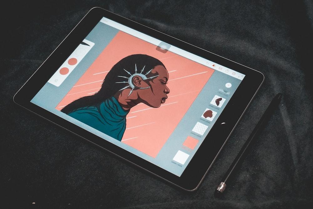space gray iPad displaying illustration of woman