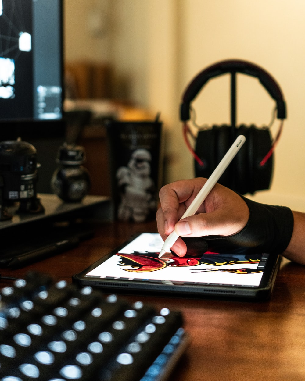 close-up photography of person drawing on tablet computer