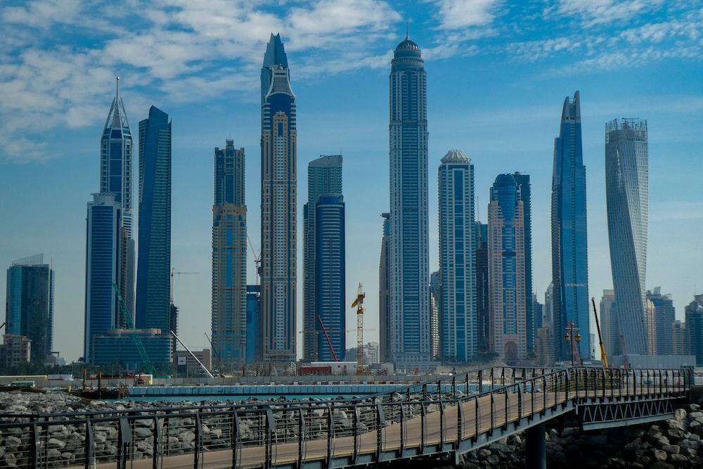 blue concrete city buildings under white and blue cloudy sky