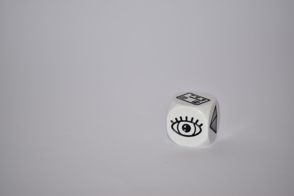 white dice on white surface
