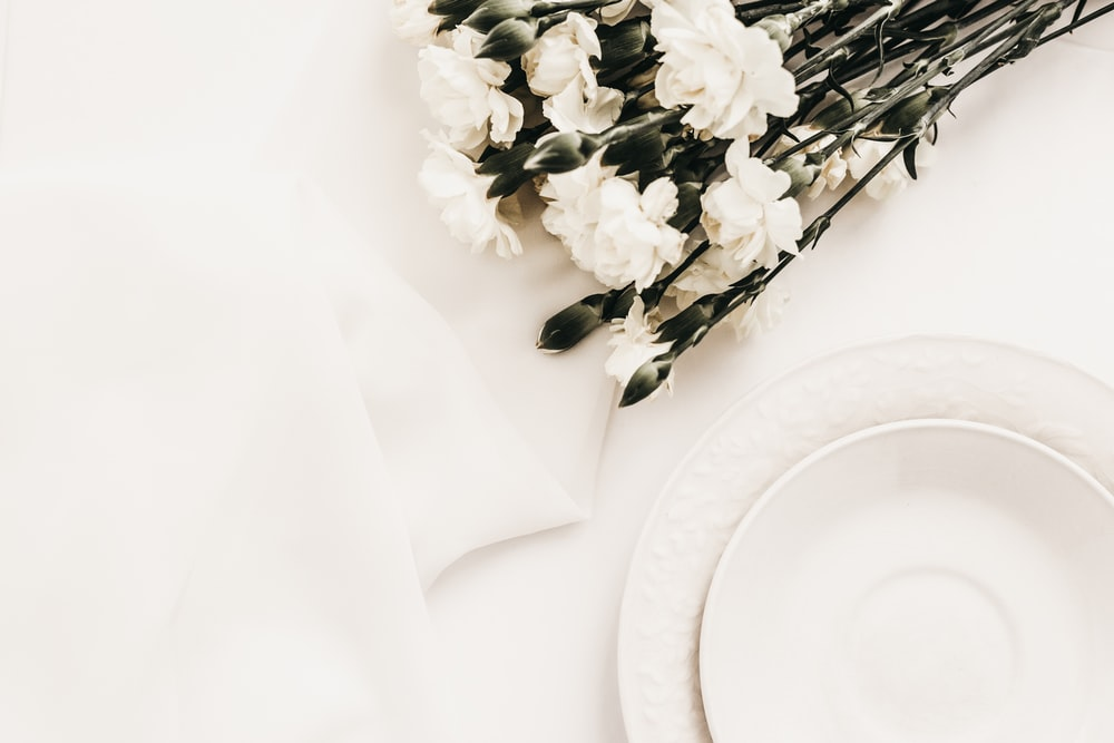 round white ceramic plate on white surface