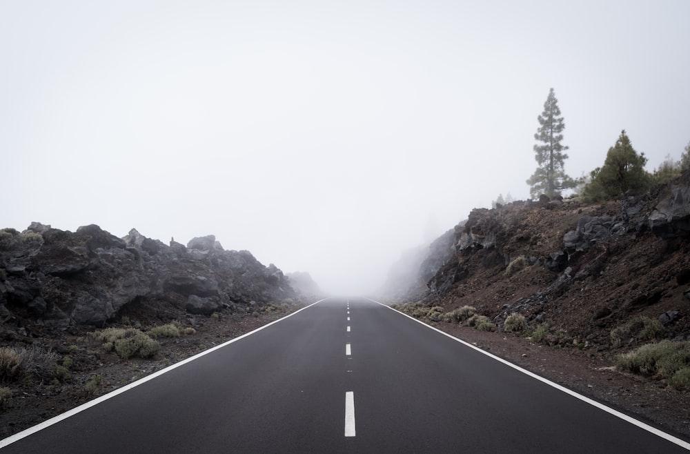 gray roads between mountains