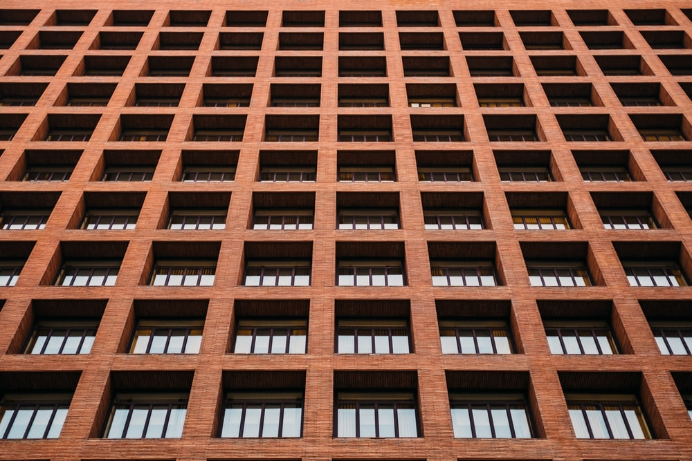 brown concrete building at daytime