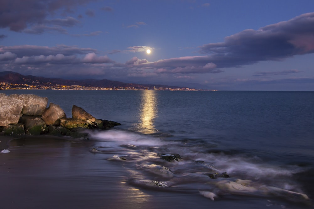 view of moon over the sea