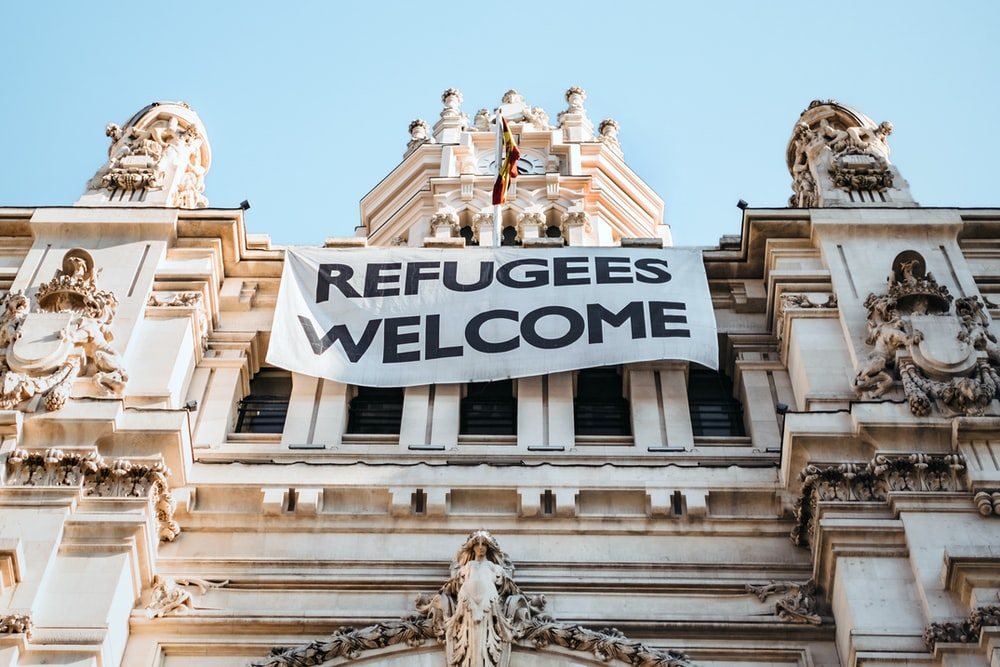 building with refugees welcome signage