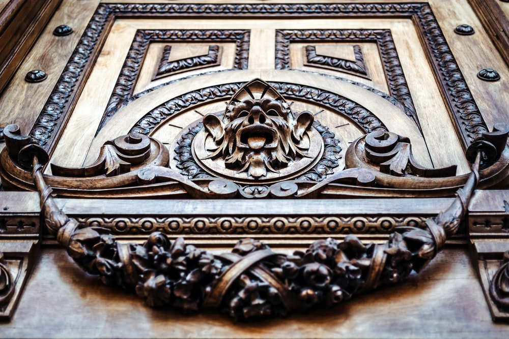 brown and black face embossed wall decor