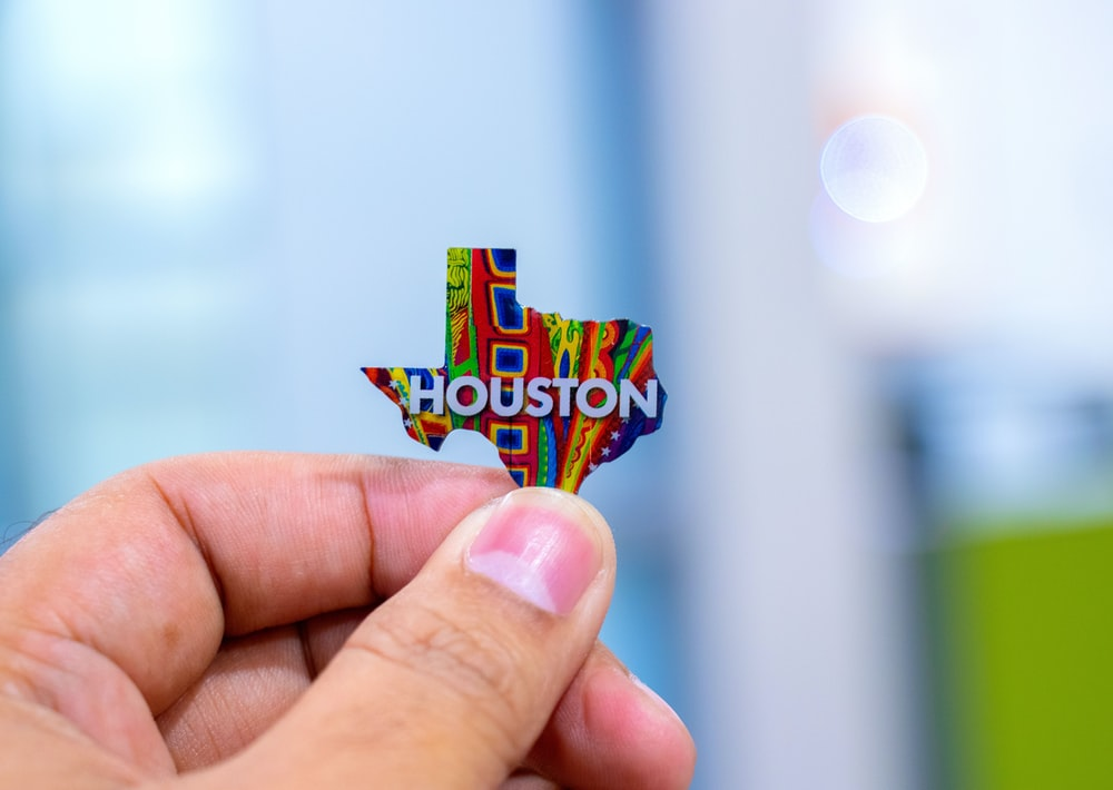 person holding Houston map decor