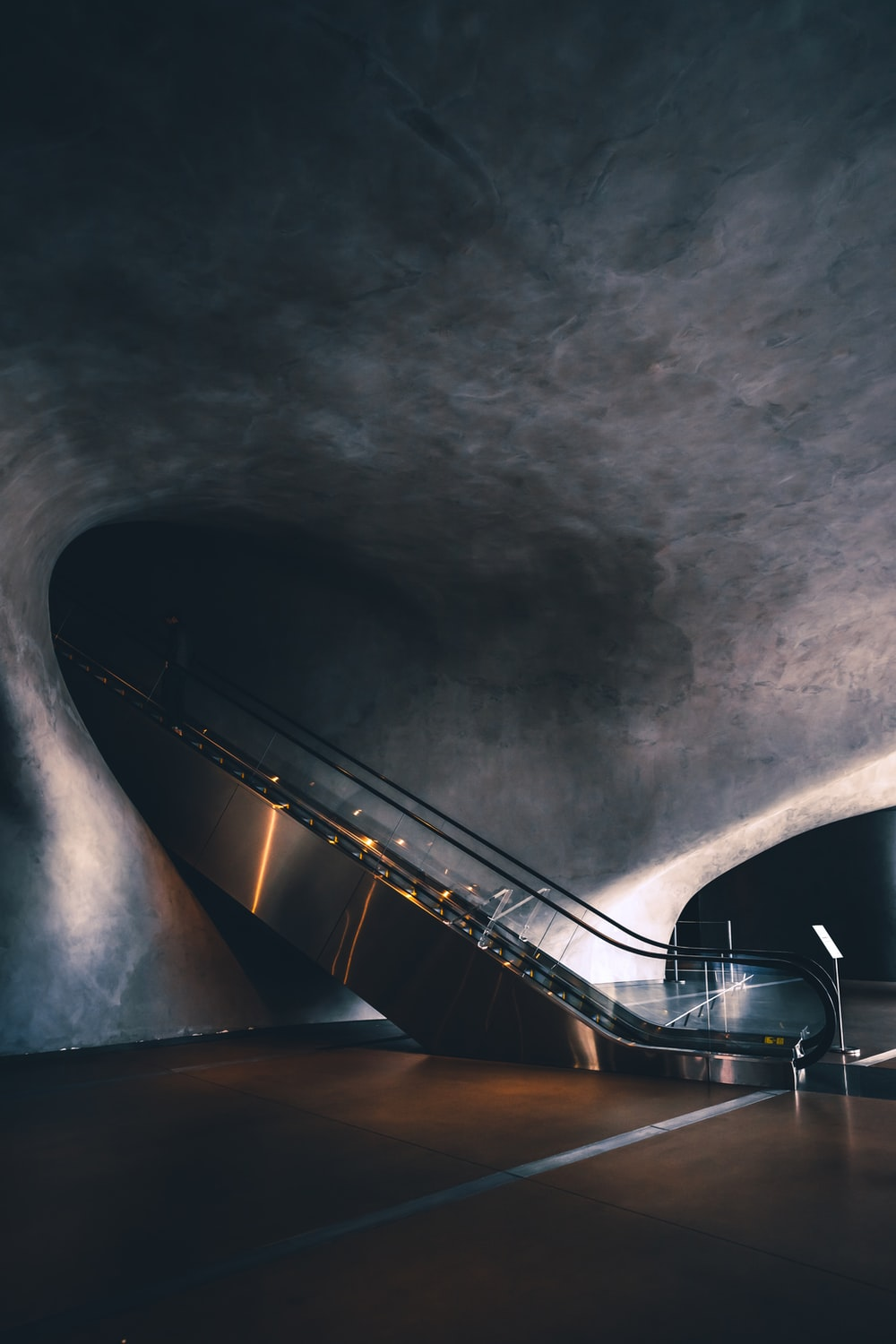 grey stairs under grey concrete ceiling