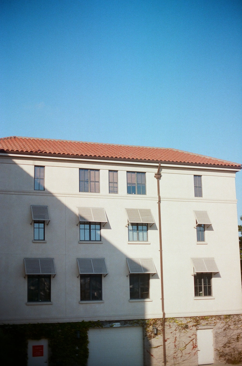 white and brown 4-storey building