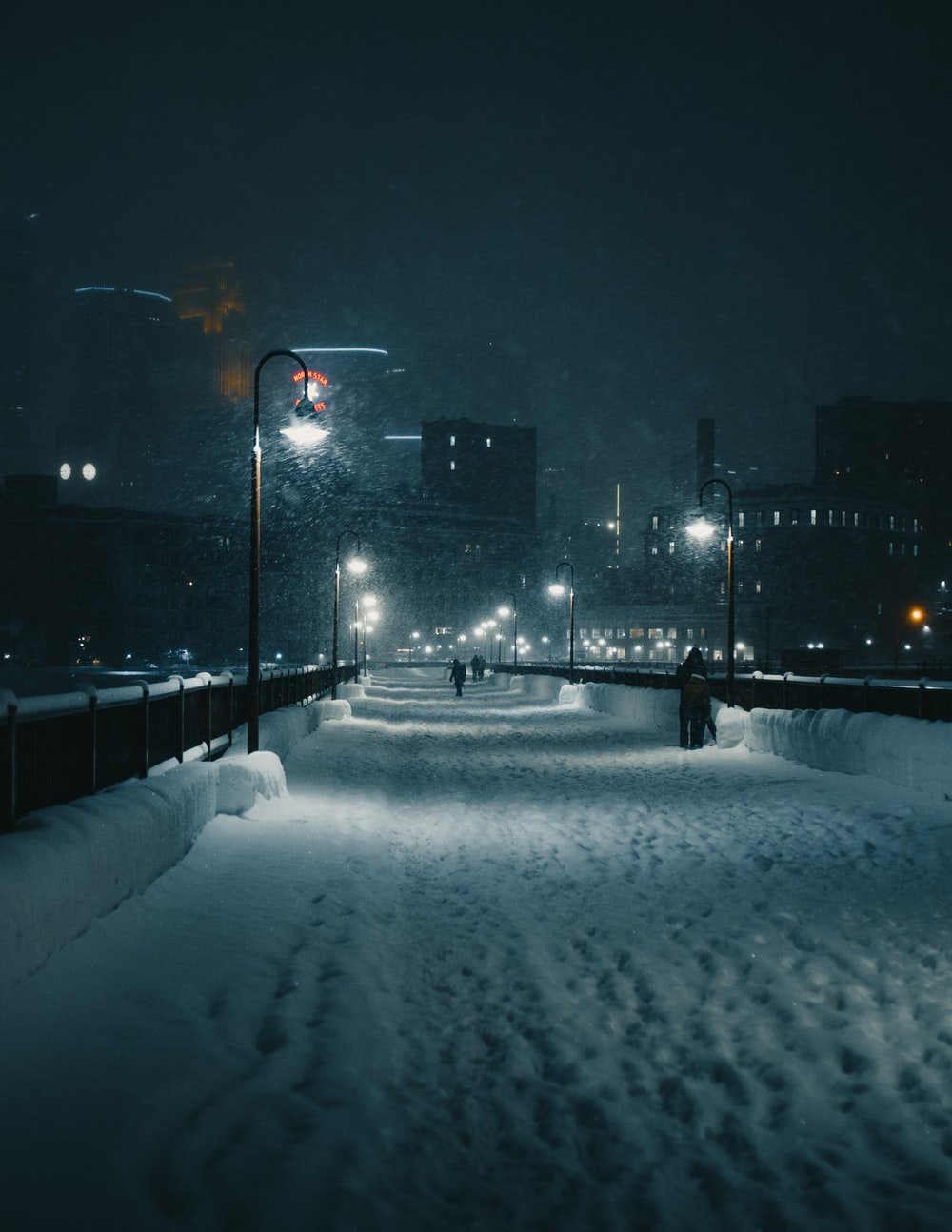 snow covered road at night