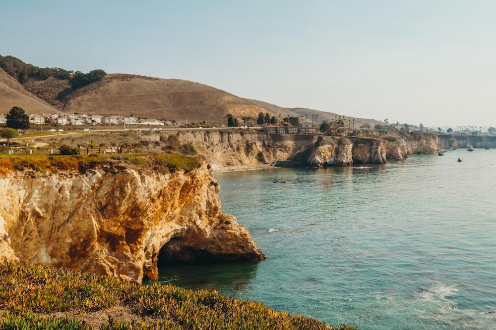 cliff near ocean during daytime