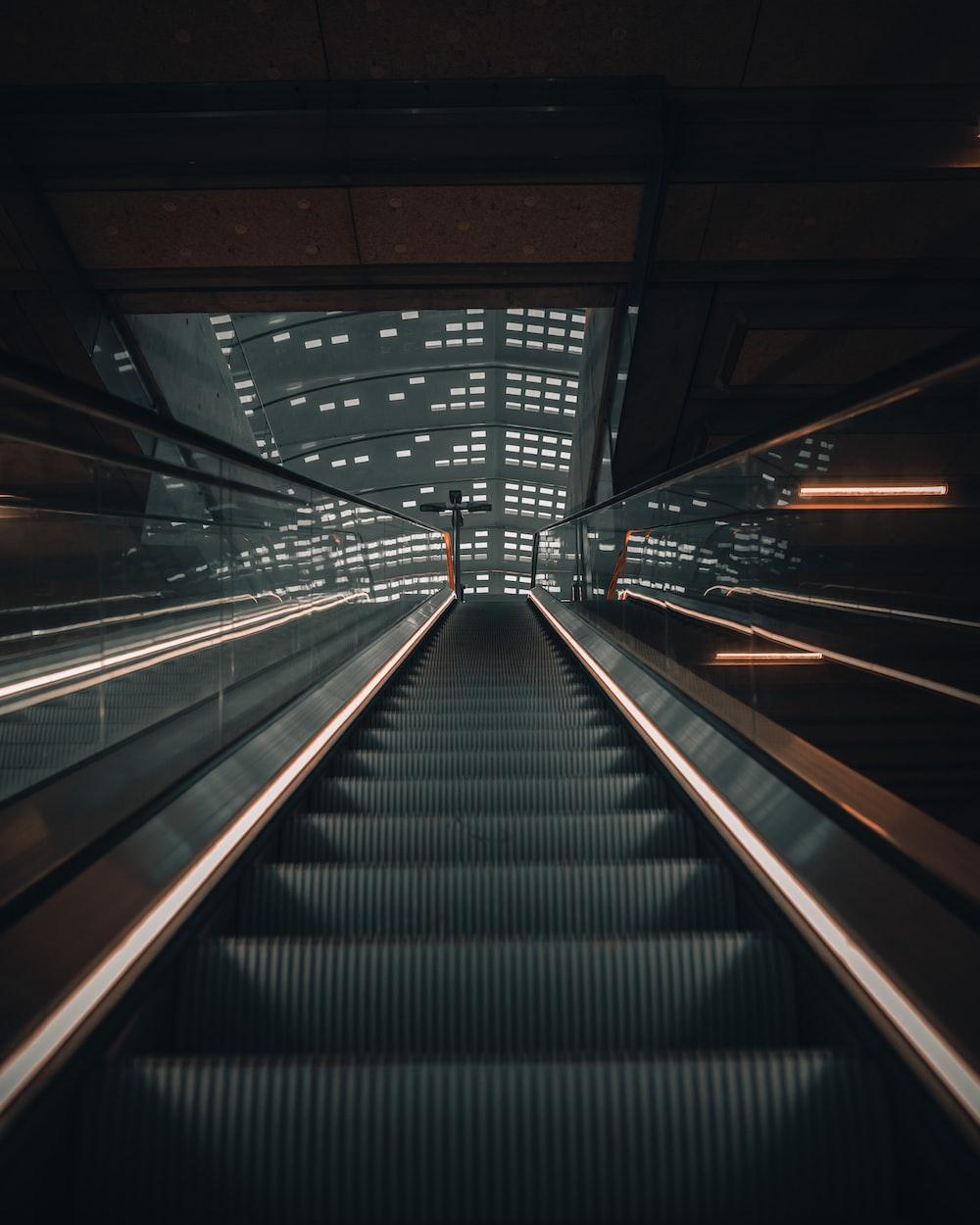 black and gray escalator inside building