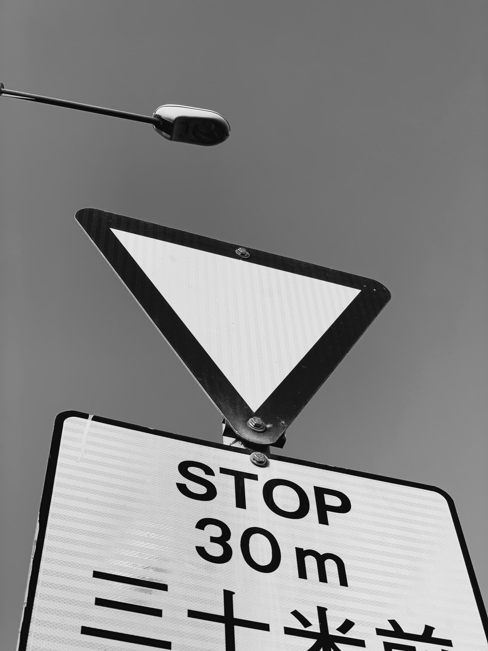 grayscale photography of road signage