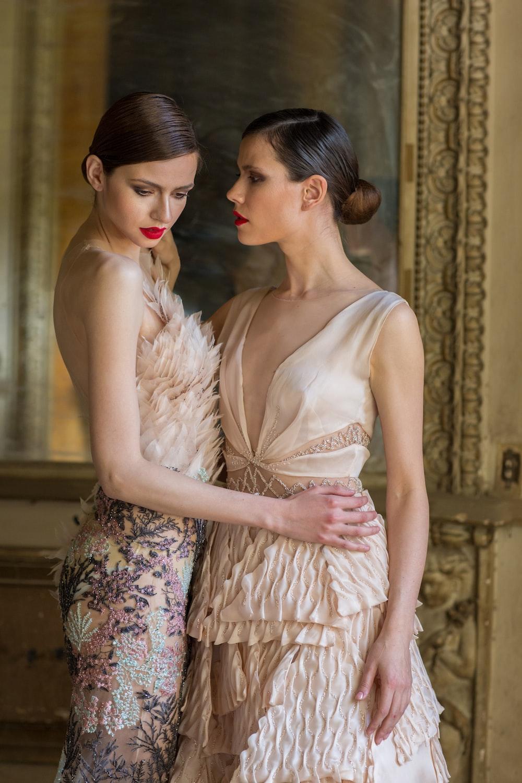 two women in beige dresses