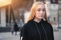 woman wearing pull-over hoodie