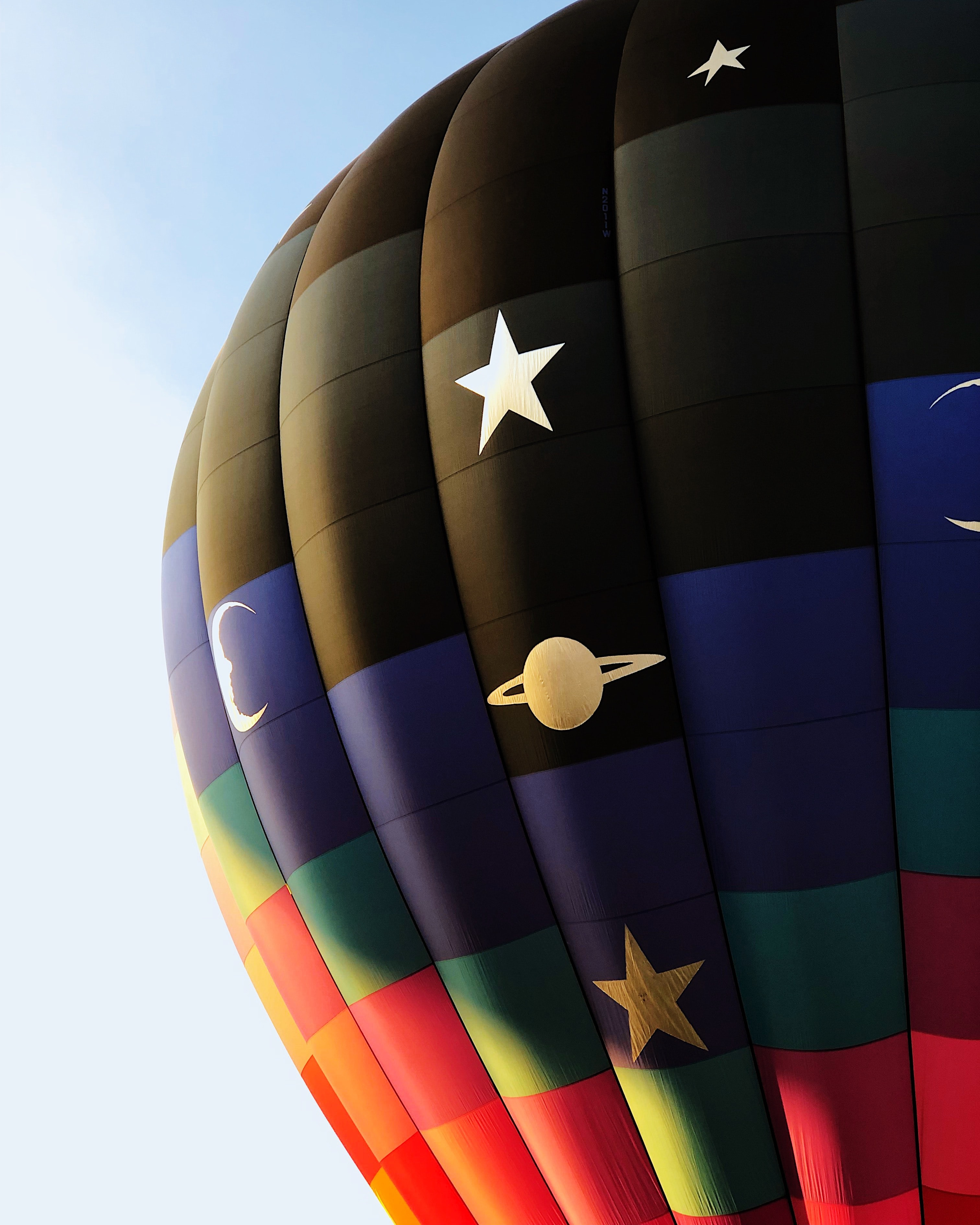 black, blue, and red hot air balloon during daytime