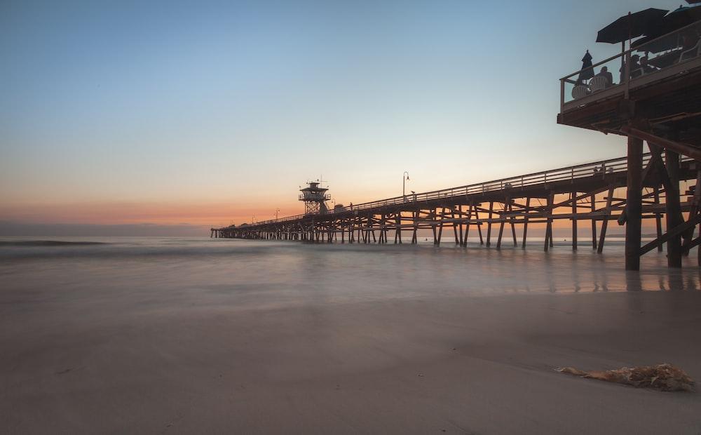 brown wooden beach boardwalk