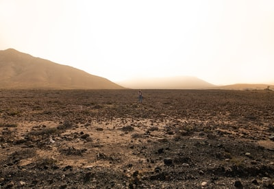 grey field during daytime ground zoom background