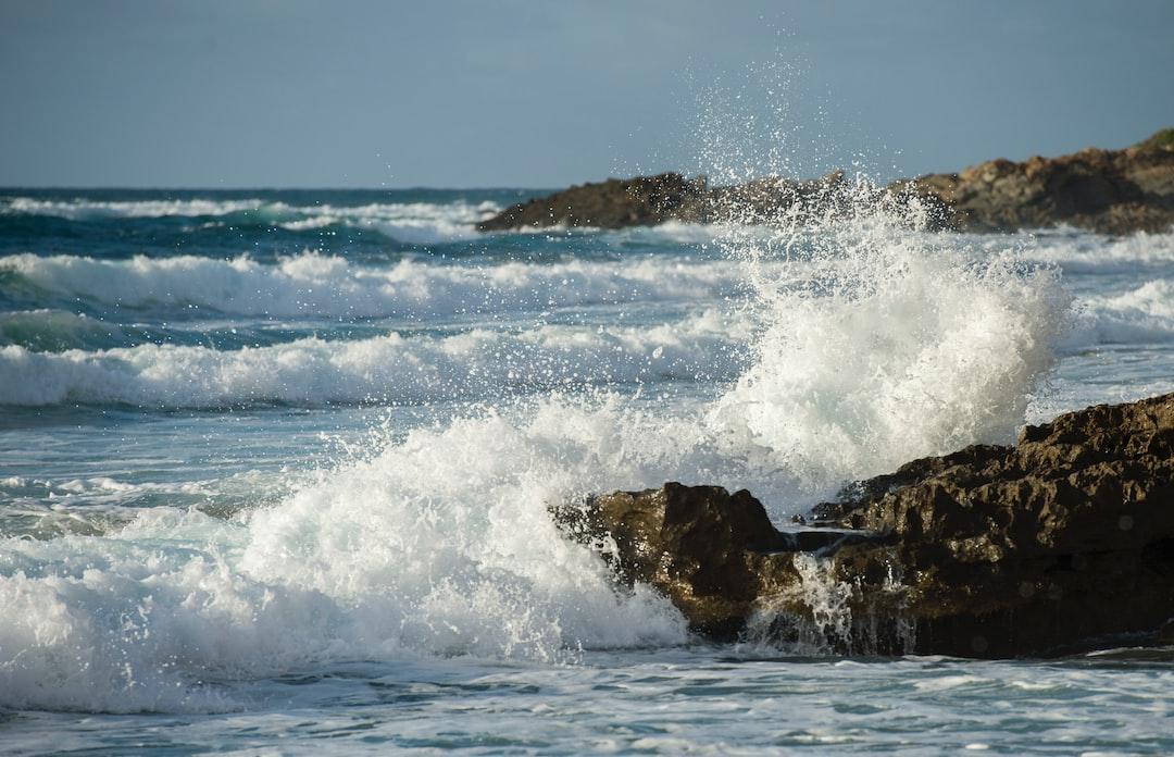 Waves crash against the rocky coast of Sardinia