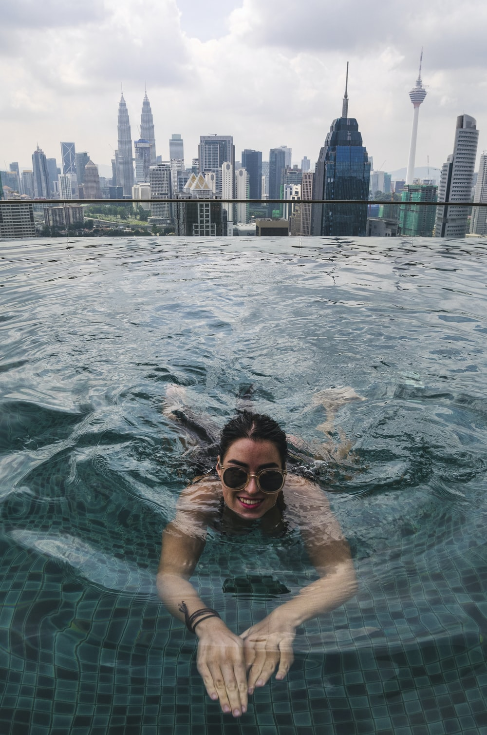 smiling woman swimming on pool