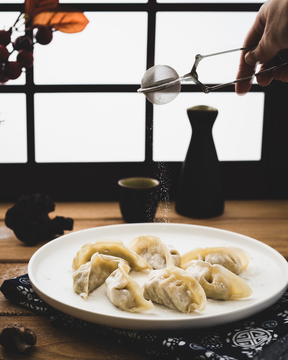 plate of dumplings on wooden surface