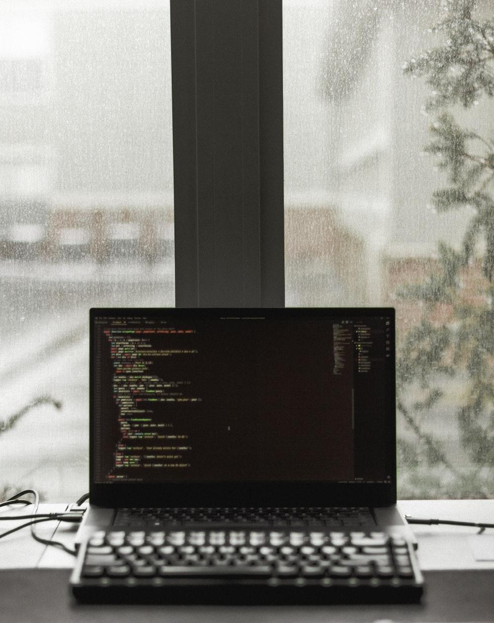 black laptop computer displaying brown screen