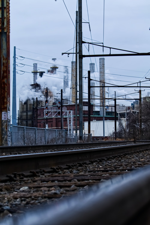 brown metal train rail at daytime