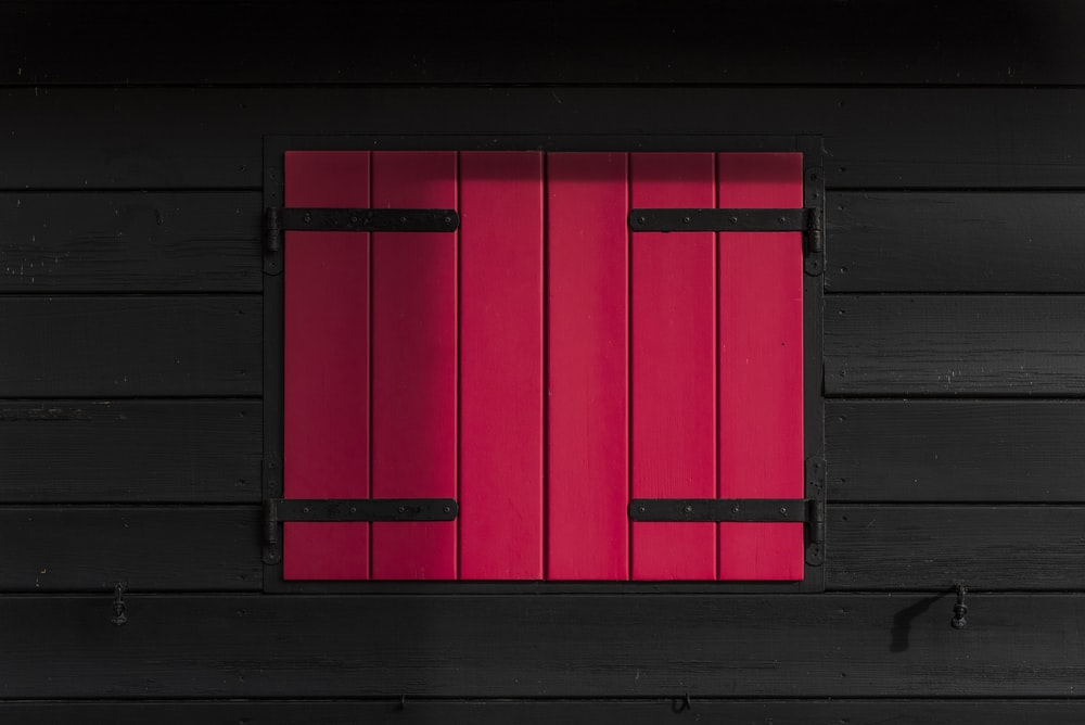 red and black wooden window