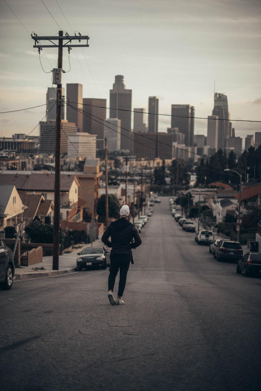 man walking on road during daytime