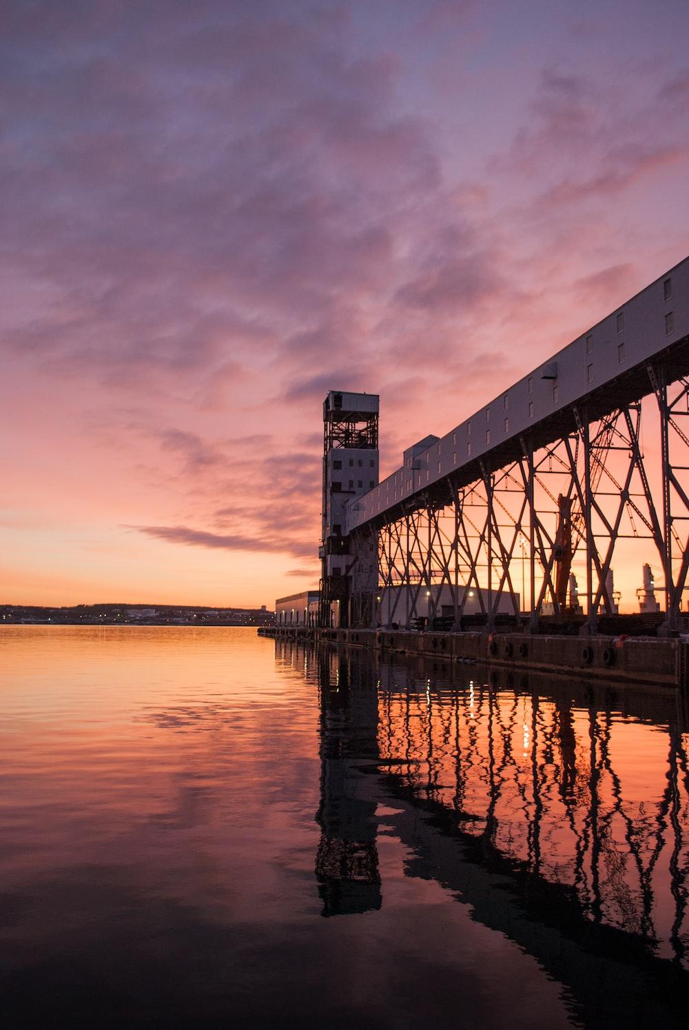 grey bridge on body of water