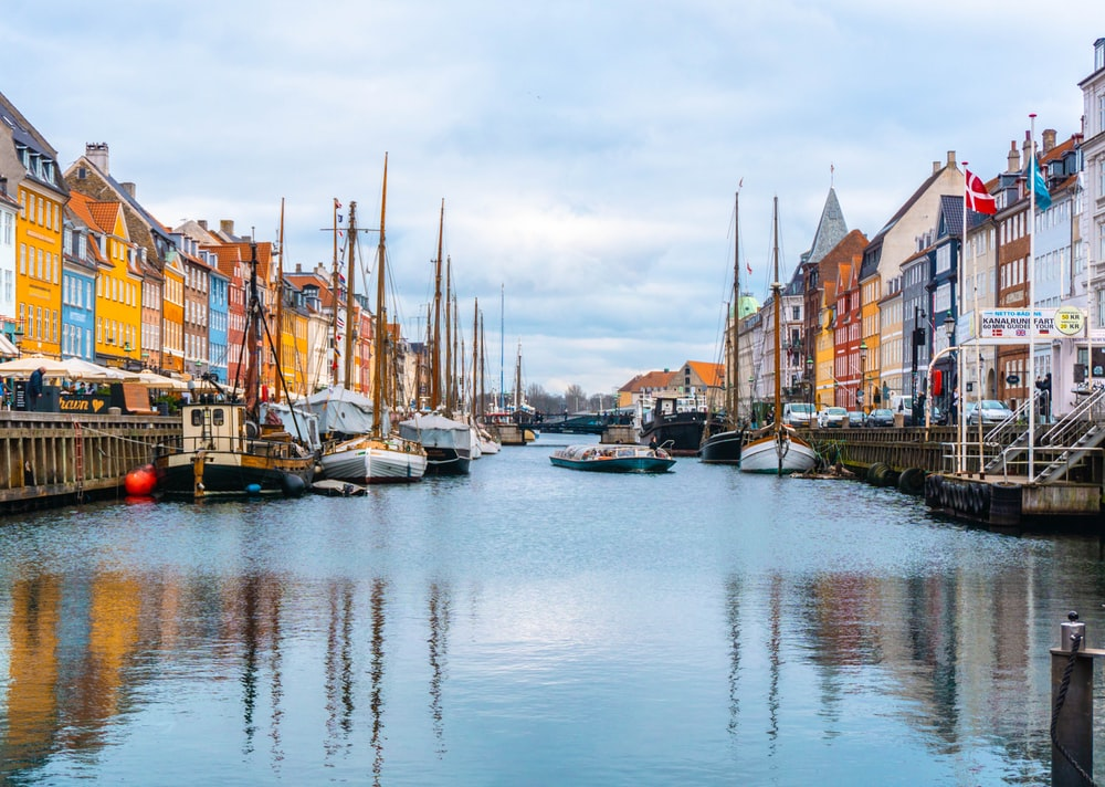 boats in canal in Denmark during daytime