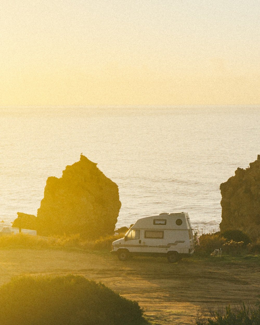 white motorhome near cliff during daytime