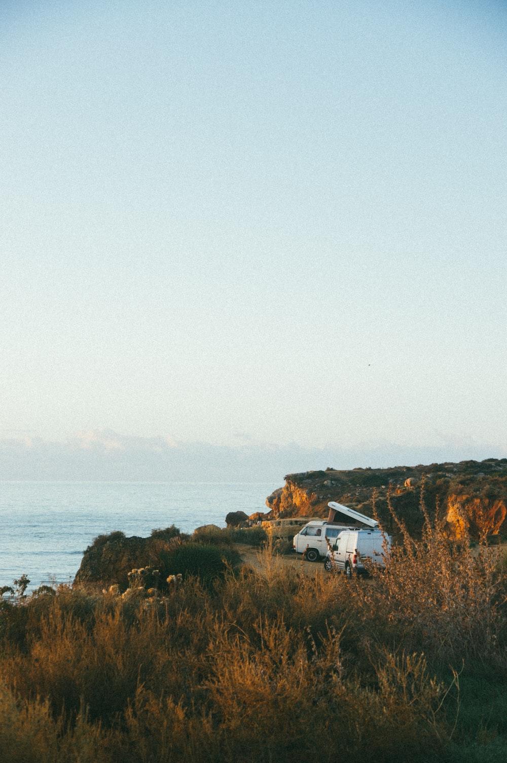 white van near cliff during daytime