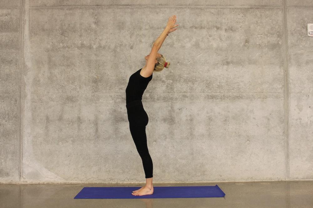 woman doing yoga on yoga mat