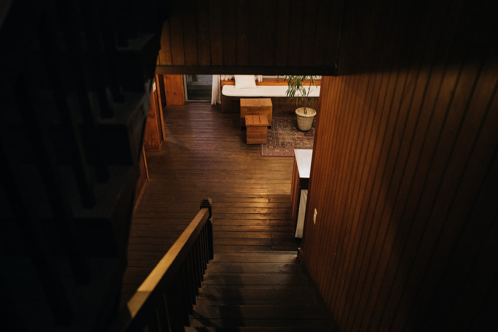 brown wooden stairs inside house