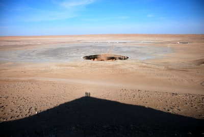 brown deserted place with hole in middle turkmenistan teams background