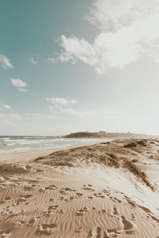 footprints in the sands near seashore