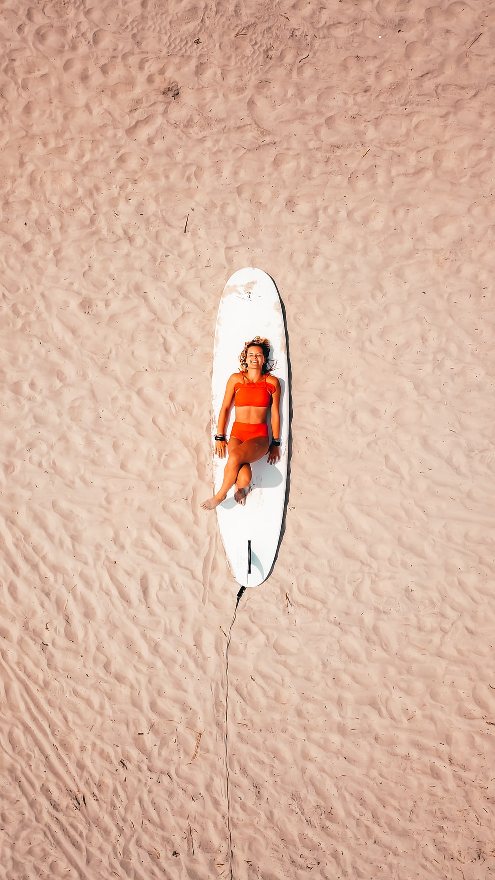 woman lying on the surfboard