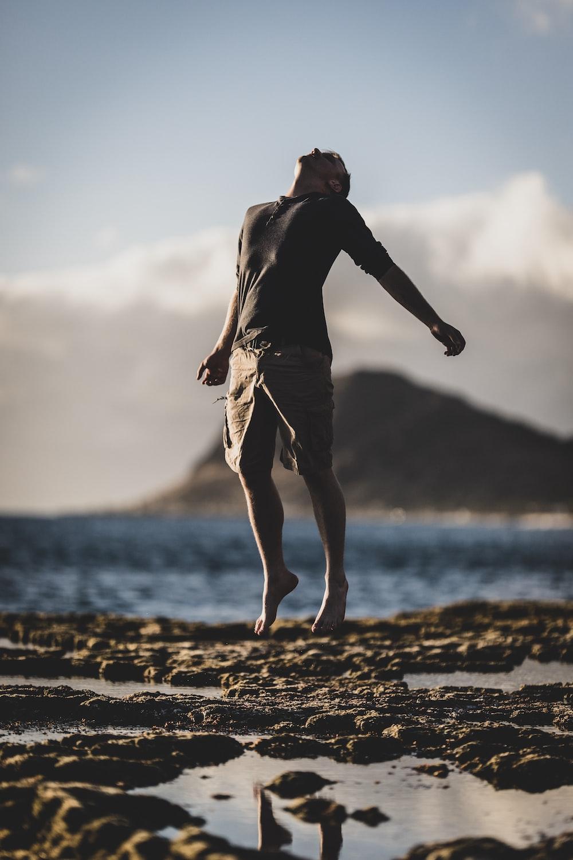 man standing near seashore