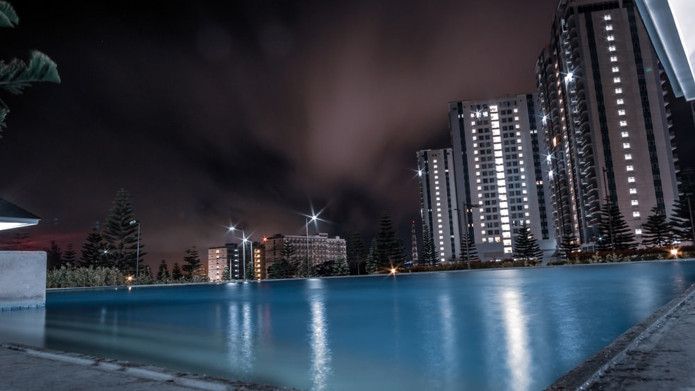 swimming pool near building at night