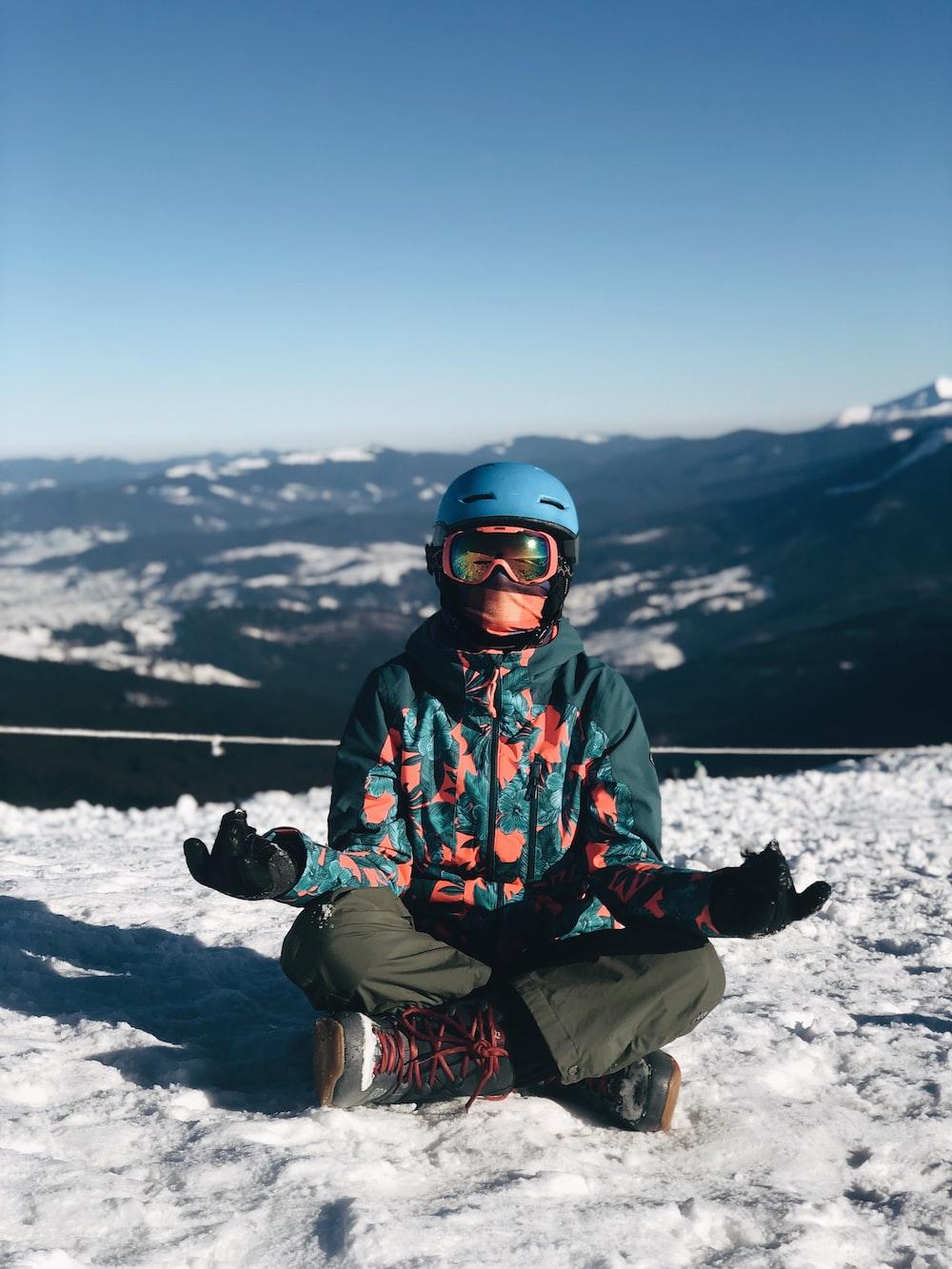 person meditating on snow field