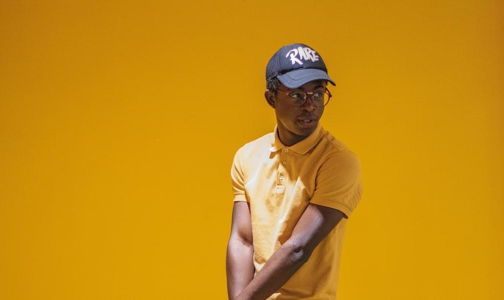 man in yellow polo shirt