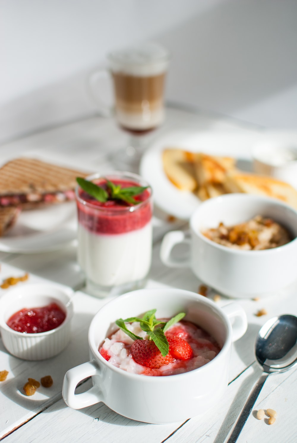 berries in white ceramic cup